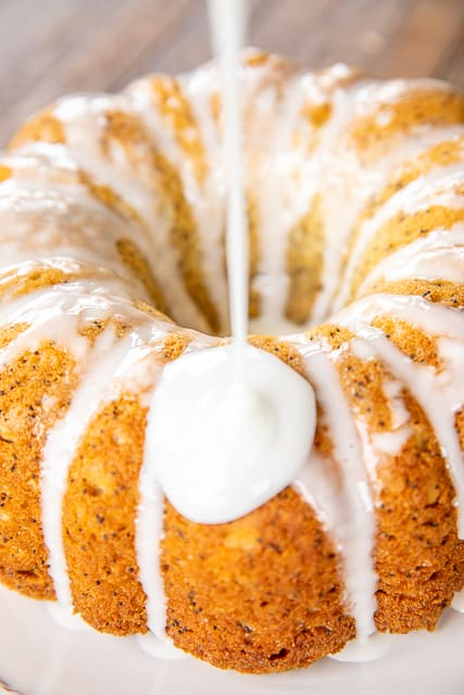pouring icing on a bundt cake