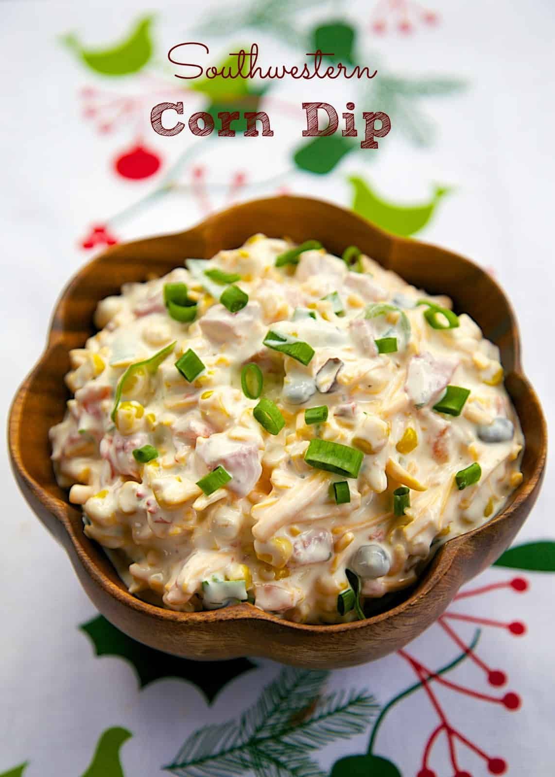 Southwestern Corn Dip - southwestern corn, mayo, sour cream, Rotel, green onions, cheese - quick & delicious dip! People go CRAZY over this easy dip recipe! It is my most requested dip recipe! I can't go to a party without bringing this Mexican dip! Make it ASAP! It is SO good!!