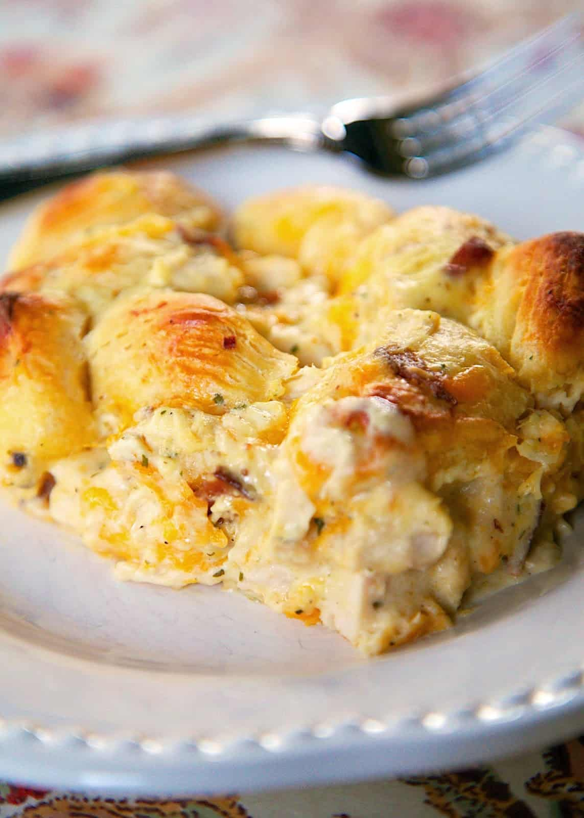 """Cracked Out"" Chicken Bubble Up Recipe - chicken, cheddar bacon, ranch, chicken soup, sour cream and biscuits baked casserole. SO addictive! I literally licked my plate!"