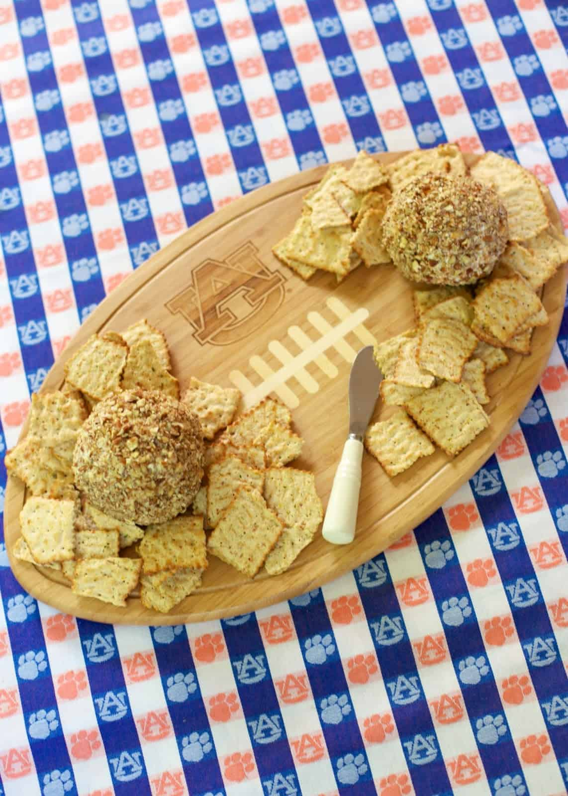 Cracked Out Cheese Ball - easy cheese ball recipe loaded with cheddar, bacon and ranch. Roll cheese ball in pecans. This is always one of the first things to go!! Great for parties and tailgates!!