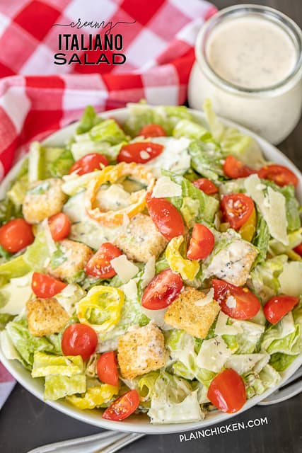 Creamy Italiano Salad - our favorite salad!!! Romaine, tomatoes, thinly sliced seedless cucumbers, sliced banana peppers, croutons and homemade Creamy Italiano dressing. The dressing really puts this salad over the top!!! Mayonnaise, red wine vinegar, milk, sugar, Italian seasoning, garlic, salt and pepper. I made this for a dinner party and everyone RAVED about it!! Give it a try for your next dinner party. You won't be disappointed! #salad #saladdressing #sidedish #vegetables #nobake