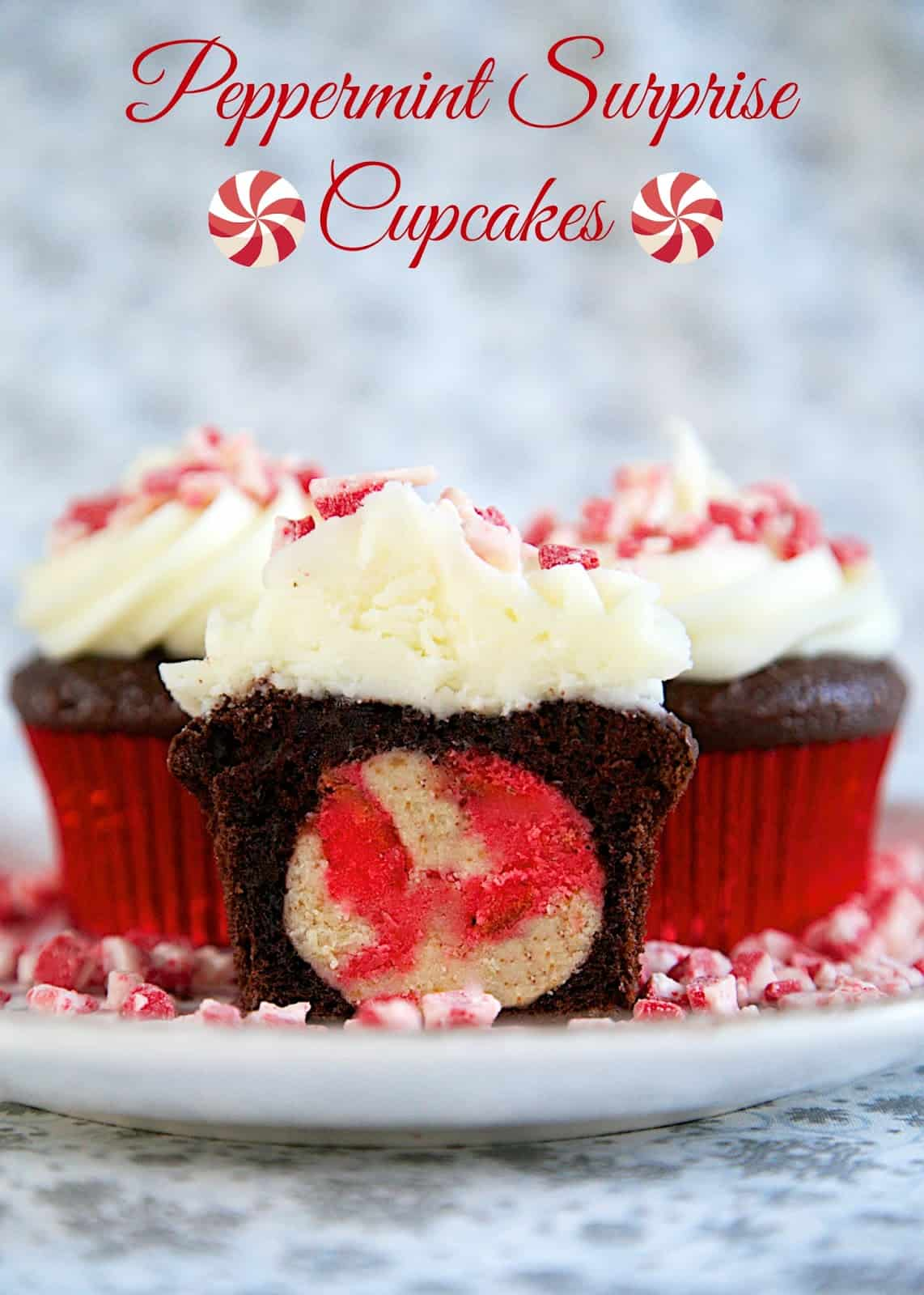 Peppermint Surprise Cupcakes - chocolate cupcakes with peppermint cake balls baked inside. Topped with homemade peppermint buttercream. The best cupcakes I've ever had!