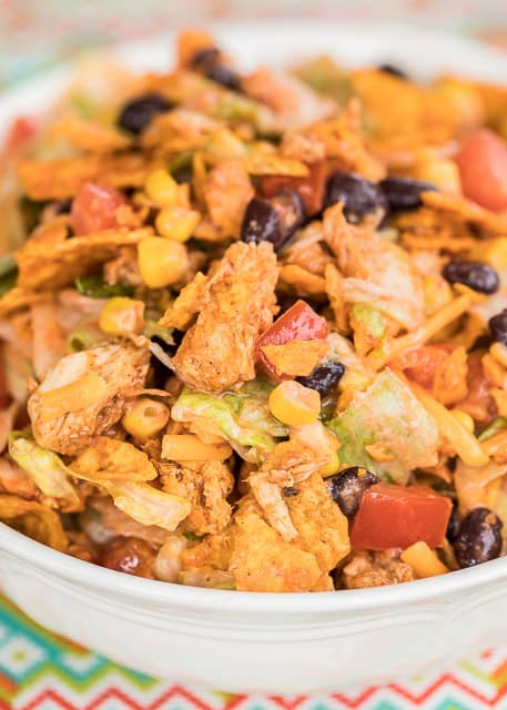 Doritos Chicken Taco Salad - you can't beat Doritos for dinner!!! Use a rotisserie chicken and this salad comes together in minutes! Great for a crowd! Just put a bowl out and let everyone graze! Chicken, corn, lettuce, black beans, taco seasoning, tomatoes, catalina dressing, ranch dressing and Doritos. SO good!! We never have any leftovers!
