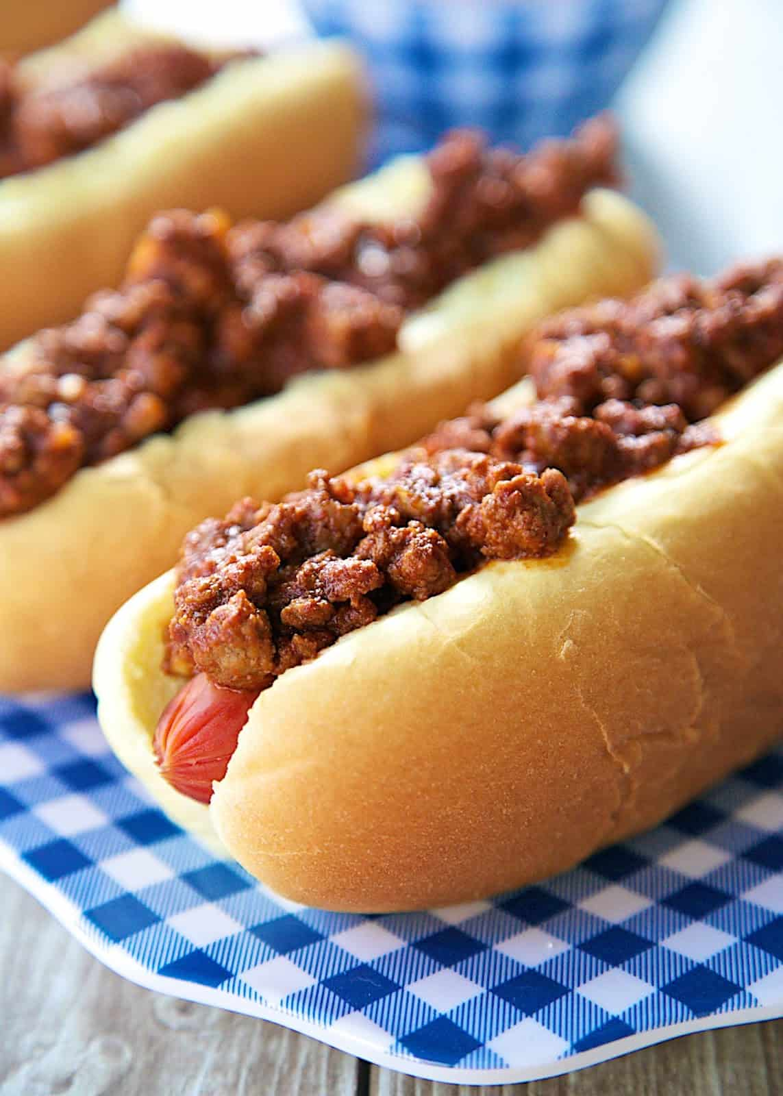 Dr. Pepper Chili Dogs Recipe - hot dogs topped with a sweet and tangy Dr. Pepper chili - great for your Summer cookouts! Ready in under 30 minutes!