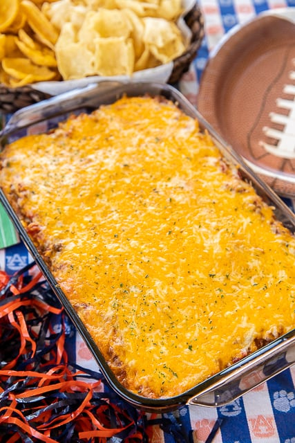 Enchilada Dipping Rice - seriously delicious!! Serve as a dip with chips or as a main dish. Everyone LOVES this yummy Mexican casserole!!! Ground beef, taco seasoning, enchilada sauce, cheese soup, refried beans, rice and cheese. Can make in advance and refrigerate until ready to bake. We make this at least once a month! SO good!!! #mexican #casserole #dip