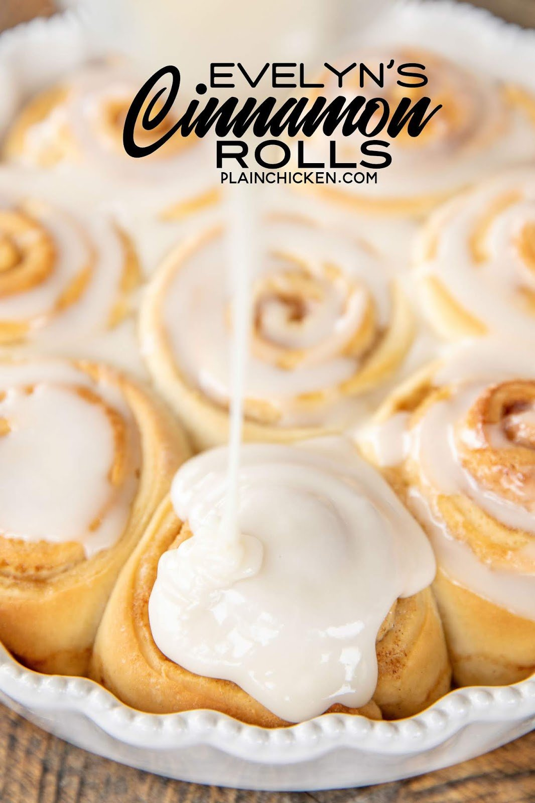 Pouring icing on homemade cinnamon rolls