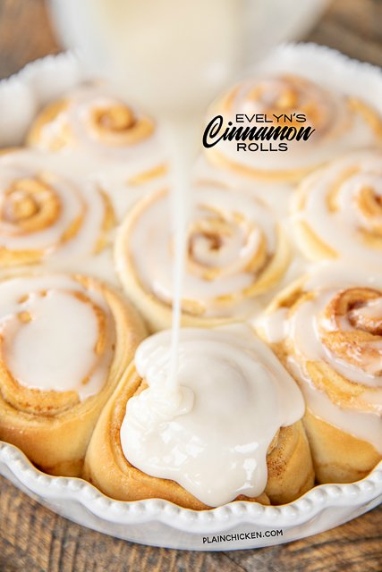 pouring frosting over homemade cinnamon rolls