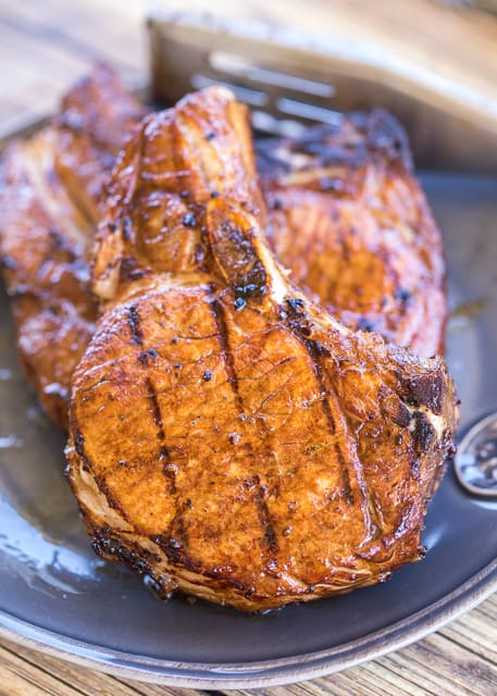 Favorite Grilled Pork Chops - the search is over. These are hands-down THE BEST pork chops!! SO easy and they taste amazing! Better than any restaurant! Pork chops marinated in worcestershire sauce, balsamic vinegar, soy sauce, olive oil, garlic, pepper and cayenne pepper. Let marinate overnight and grill for the BEST pork chops EVER. Such a quick and easy grilled pork recipe!
