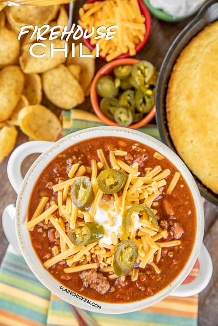 chili in a bowl with cheese and jalapenos