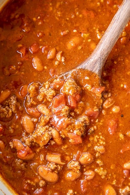 chili in a pot with a spoon