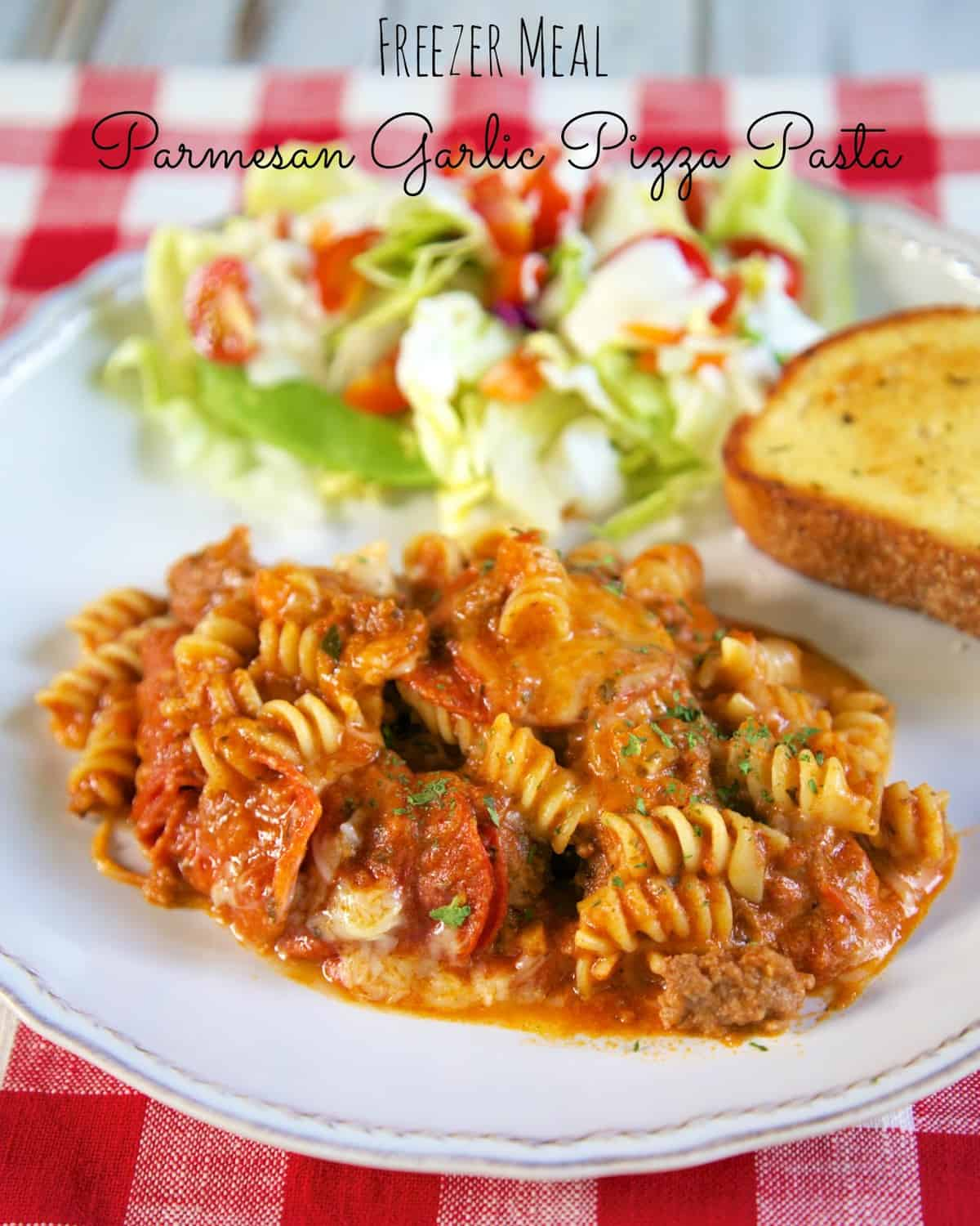 Slow Cooker Parmesan Garlic Pizza Pasta - FREEZER MEAL - just dump everything in the bag and freeze for a quick meal later. Ground beef, pepperoni, onion, garlic bread seasoning, marinara, water, mozzarella and pasta. No need to cook the ground beef or pasta ahead of time. It all cooks in the slow cooker. #slowcooker #freezermeal #kidfriendly
