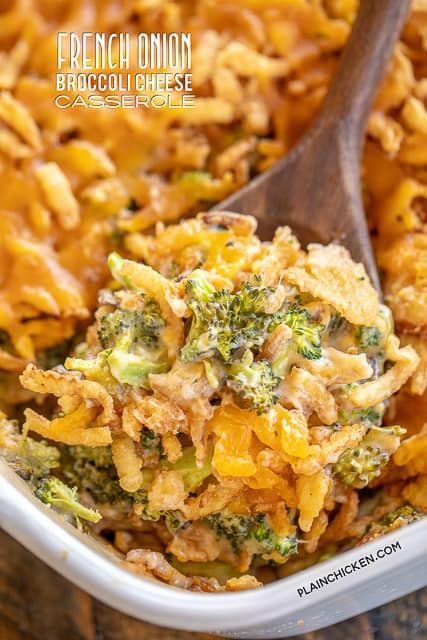 scooping broccoli casserole from baking dish