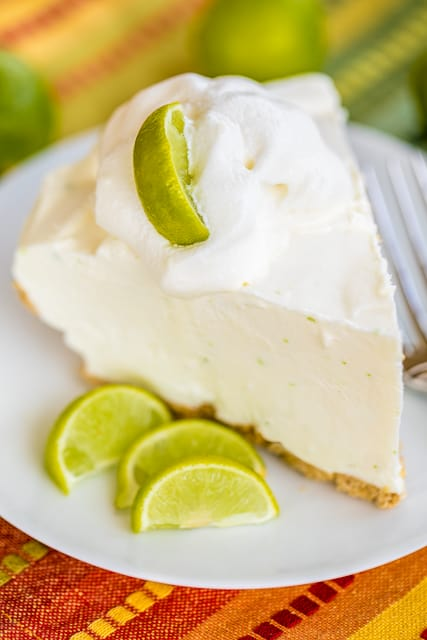 Frozen Key Lime Box Pie - only 4 ingredients! A store-bought graham cracker crust filled with a no churn key lime ice cream made with key limes, heavy cream and sweetened condensed milk. Only takes a minute to make and it tastes amazing! Fantastic key lime flavor! I made this for a party and it was gone in a flash! Everyone asked for the recipe!!