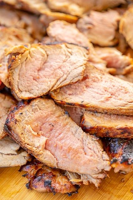 Ginger Ale Pork Tenderloin - the BEST pork tenderloin I've ever made! SO good!! Pork tenderloin marinated in ginger ale, dijon mustard, honey, oil, onion powder, rosemary, garlic, salt and pepper. Hands-down THE BEST pork EVER! Marinate overnight and grill. Great leftover too! #grill #pork #grilling #porktenderloin