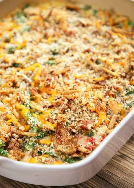 Cheddar-Pecan Green Bean Casserole - no cream of anything soup!! Fresh green beans and roasted red peppers tossed in a yummy buttermilk ranch sauce and topped with cheddar, pecans, and french fried onions. Not your grandmother's green bean casserole. This casserole is to-die-for! Can make the buttermilk ranch sauce and blanch green beans ahead of time for easy holiday meal prep!