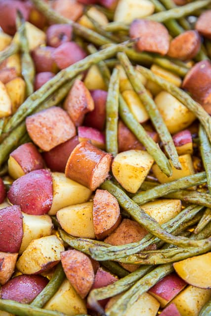 Roasted Green Beans, Potatoes and Smoked Sausage - easy sheet pan meal! Can be a main dish or side dish. SO easy! Only 5 ingredients and ready in 40 minutes!! Red potatoes, green beans, and smoked sausage tossed in olive oil and cajun seasoning. Great weeknight meal! #sheetpanmeal #sidedish #veggies