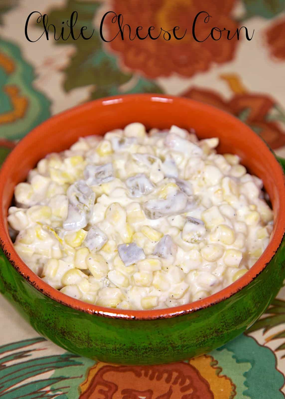 Chile Cheese Corn Recipe - corn, cream cheese, green chiles and spices - super quick side dish that is ready in under 10 minutes! Great with tacos and fajitas!