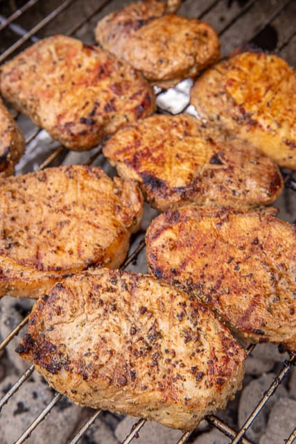 Grilled Greek Pork Chops - hands down the BEST pork chops I've ever eaten! Marinated in olive oil, lemon juice, Worcestershire sauce, onion powder, garlic powder, ground mustard, salt and pepper. I made these for a cookout and everyone raved about them. I had to give everyone the recipe!!! SO simple and SOOO delicious!!! #grilling #porkchops #grill #pork