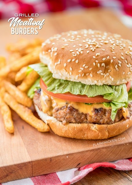 burger and fries on a cutting board