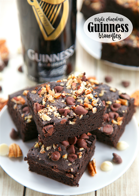 Triple Chocolate Guinness Brownies - super rich and fudgy brownies loaded with dark chocolate, white chocolate and semi-sweet chocolate. Super easy to make - they are ready for the oven in minutes. Serve warm with a big scoop of vanilla ice cream! They were a huge hit in our house!