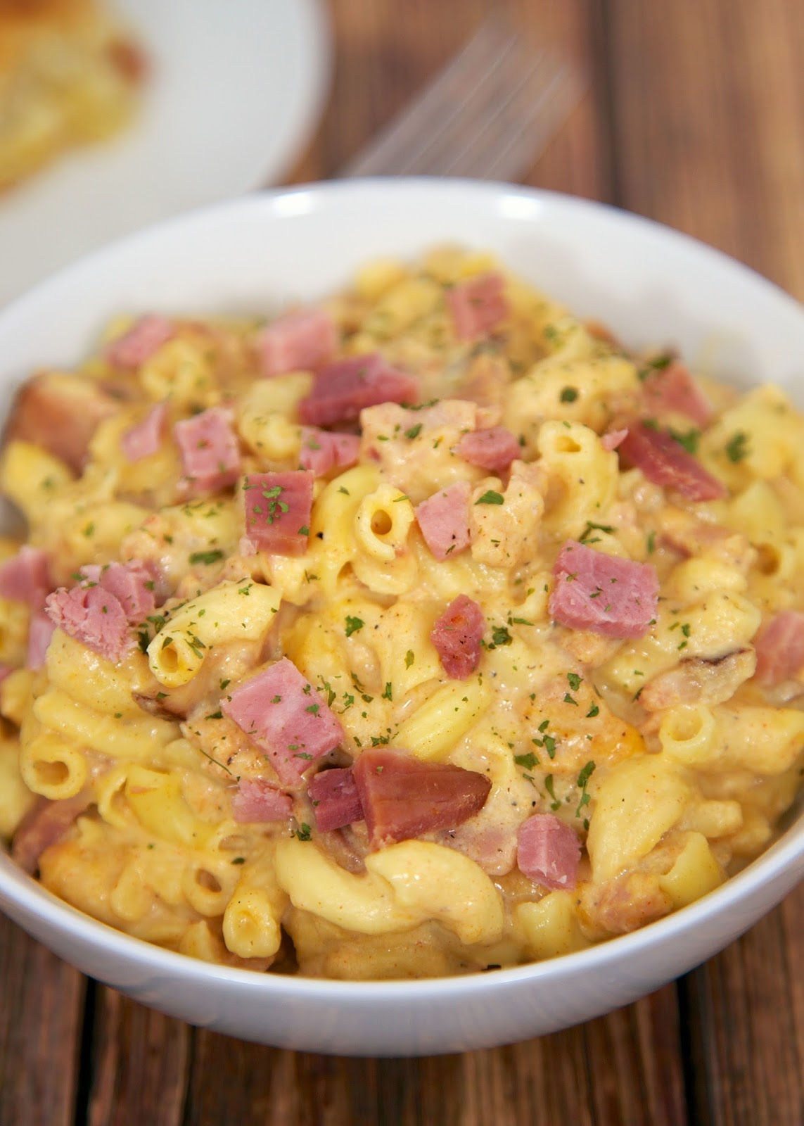 Slow Cooker Macaroni & Cheese with Ham - great flavor and ready in 90 minutes. Can serve without ham as side dish. Macaroni, ham, milk, dijon mustard, onion powder, garlic powder, paprika, salt, pepper and cheddar cheese. Our FAVORITE mac and cheese recipe!!