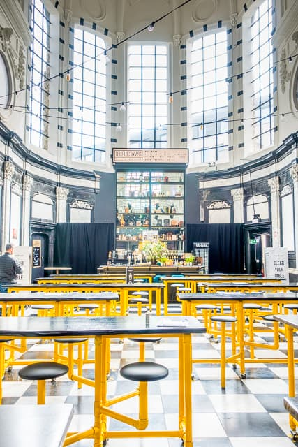Foodie Heaven at Holy Food Market in Ghent, Belgium - a MUST on your trip to Belgium. The Holy Food Market is an amazing food hall inside an old church. It is such a fun experience and the food was AMAZING!!! Ghent is a short train ride from Bruges and Brussels. Definitely add Ghent and the Holy Food Market to your bucket list!