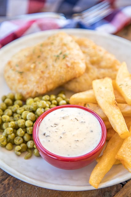 Homemade Tartar Sauce - you'll never buy jarred tartar sauce again!! Perfect with our favorite SeaPak Fish and Chips. This sauce is great on everything, not just fish!! I wanted to lick the bowl!! Would be a great dipping sauce for fried pickles, fried chicken tenders, salmon - really anything! #tartarsauce #fishrecipe #saucerecipe #easysaucerecipe