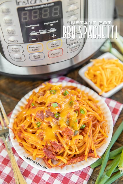 spaghetti on a plate with an Instant Pot in the background