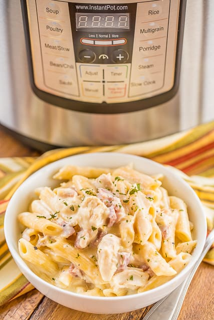 Instant Pot Chicken Cordon Bleu Pasta - only 4 minutes of cook time! Chicken, ham, dijon mustard, garlic, cream cheese, penne pasta, chicken broth, water, swiss cheese and parmesan. Crazy delicious! We made this twice in one week. #instantpot #chicken #pasta #ham #cheese