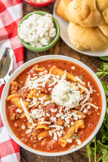 Instant Pot Lasagna Soup - I wanted to lick the bowl this was so delicious!! Tastes just like my homemade lasagna!!! Italian sausage, garlic, onion, Italian seasoning, tomato paste, tomato sauce, diced tomatoes, beef broth, spaghetti sauce and pasta. Everything cooks in the Instant Pot! SO quick and easy. Top the soup with some mozzarella and ricotta. Great with some crusty garlic bread! #instantpot #lasagna #souprecipe