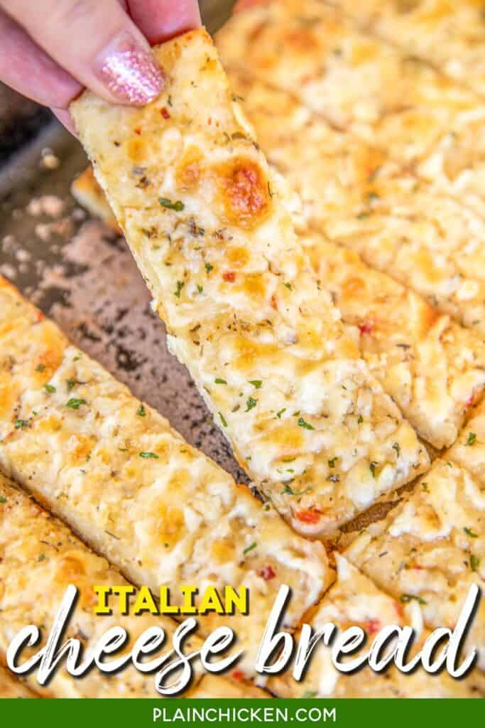 grabbing a slice of cheesy italian bread