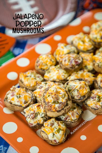 Jalapeno Popper Mushrooms - always the first thing to go at parties! Mushrooms stuffed with cream cheese, garlic, cheddar cheese, bacon and jalapeños. Seriously delicious! Can prep mushrooms ahead of time and refrigerate until ready to bake. Great for parties or a low-carb snack. #partyfood #mushrooms #jalapenopoppers