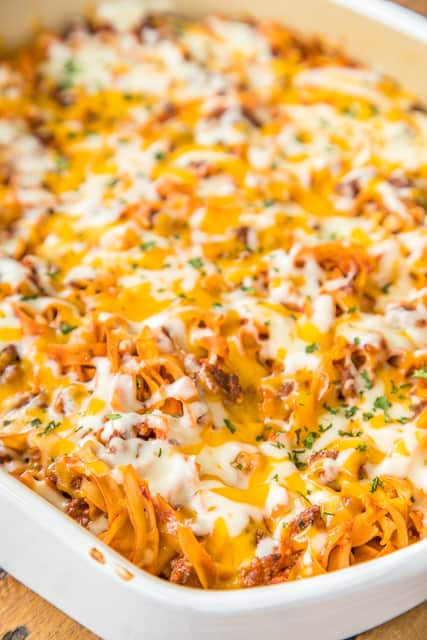 Johnny Marzetti Casserole Recipe - classic pasta casserole that will please the entire family! Ground beef, onions, tomato soup, tomato sauce, tomato paste, egg noodles, cheddar cheese and mozzarella. Can make ahead and refrigerate or freeze for later! A classic casserole that is perfect comfort food that can feed a crowd! Everyone cleans their plate! Such an easy weeknight meal!!