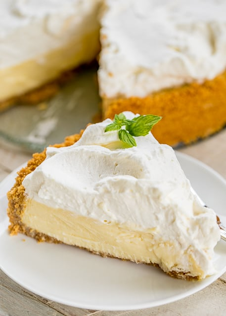 Lemon Velvet Cream Pie - hands down THE BEST lemon pie EVER!!! Everyone raves about this pie. Graham cracker crust, gelatin, egg yolks, sweetened condensed milk, whipping cream and lemon juice, powdered sugar. Can make a day or two in advance and top with fresh whipped cream before serving. I wanted to lick my plate! A must for all your holidays and dinner parties! #pie #dessert #lemonpie