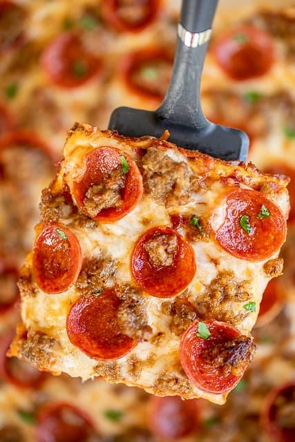 slice of pizza quiche on a spatula