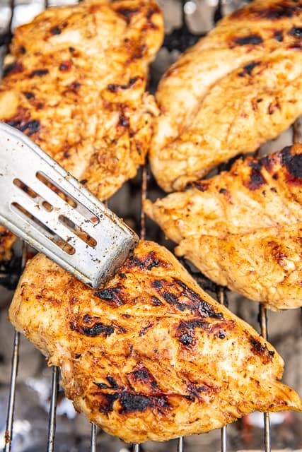 cooking chicken on a grill