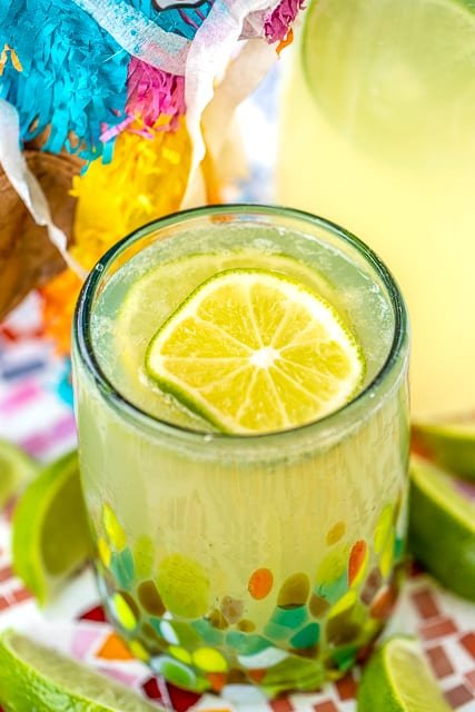Margarita Punch - great for a crowd! SO easy to make and tastes great! Limeade, Lemonade, orange extract, Sprite, water and tequila. Can leave out the tequila for a virgin margarita punch! Great for Cinco de Mayo, dinner parties and tailgating!
