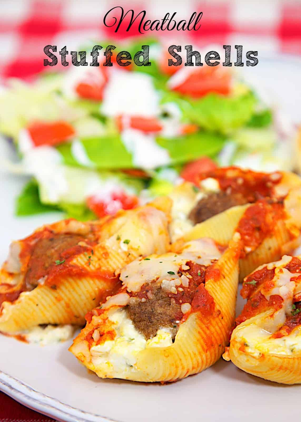 Meatball Stuffed Shells - easy weeknight pasta casserole! Fill pasta shells with frozen meatballs and top with sauce and cheese. Ready to eat in under 30 minutes!! Everyone LOVED this easy pasta casserole recipe! Can freeze for later too!
