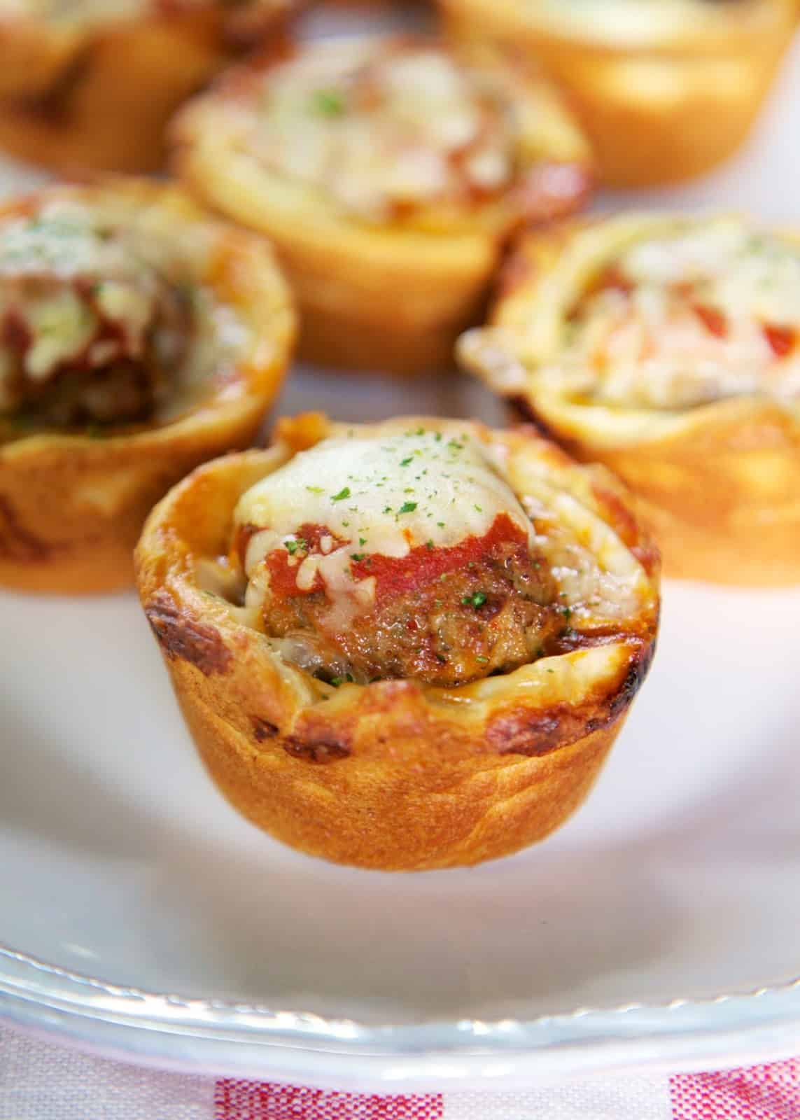 Meatball Sub Cupcakes - cream cheese, frozen meatballs, marinara and mozzarella stuffed in crescent rolls and baked in a muffin pan - SO good!! Great for lunch, dinner or a party!