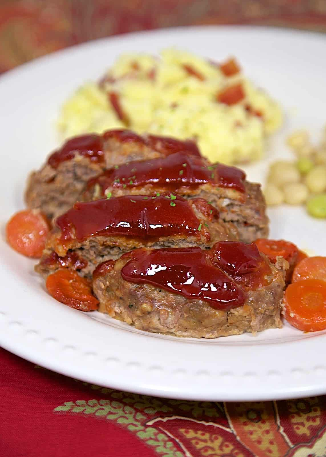 Mom's Meatloaf Recipe - comfort food at its best! This recipe makes 2 small loaves - serve one for dinner and serve leftovers as sandwiches for lunch the next day.