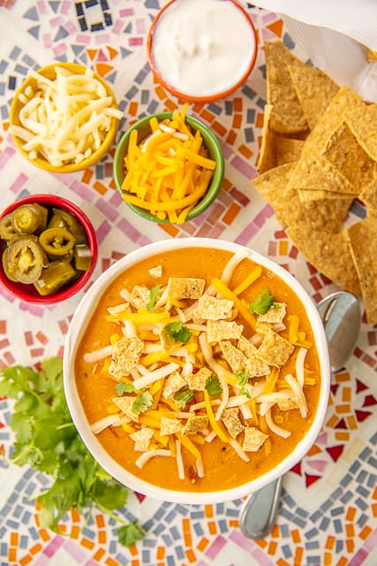 Mexican Chicken Corn Chowder - so simple and delicious!! Ready in about 30 minutes!! Chicken, creamed corn, diced tomatoes and green chiles, cumin, onion, garlic, chicken broth, half-and-half and cheese. SO creamy and delicious! Everyone went back for seconds. Such a quick and easy weeknight meal! #soup #chicken #mexican #30minutemeal #easydinner