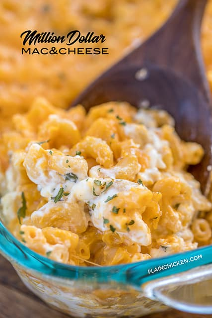 scooping mac & cheese from baking dish