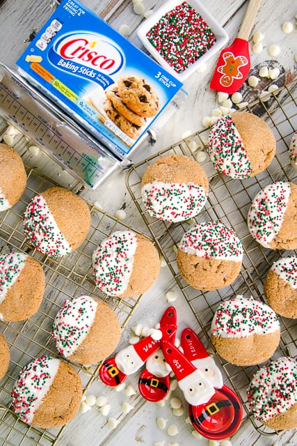 Molasses Sugar Cookies - a family favorite at the holidays! SO easy and SO delicious! Crisp on the outside and tender on the inside!! Crisco®, molasses, sugar, cinnamon, ginger, cloves, egg, flour, baking soda. Ready in minutes. Dip in white chocolate and top with holiday sprinkles for a festive addition to your cookie tray! These go fast, so you might want to double the recipe!!