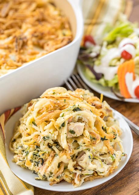 Monterey Chicken Spaghetti Casserole - my whole family went crazy over this easy chicken casserole!! Even our super picky eaters! Chicken, spaghetti, sour cream, cream of chicken, spinach, Monterey Jack Cheese, and french fried onions. Makes a great freezer meal! This is the most requested dinner in our house. #casserole #chickendinner #chickencasserole