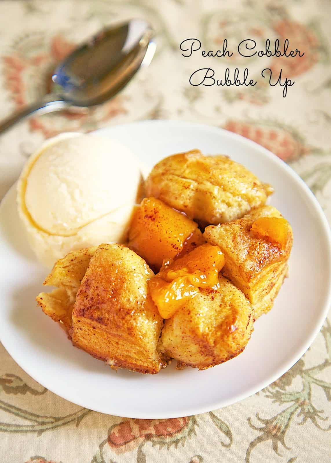 Peach Cobbler Bubble Up recipe. This dessert recipe only has 4 ingredients! It takes about 30 minutes from start to finish. We like to serve this slightly warm with a big scoop of vanilla ice cream! SO good!!