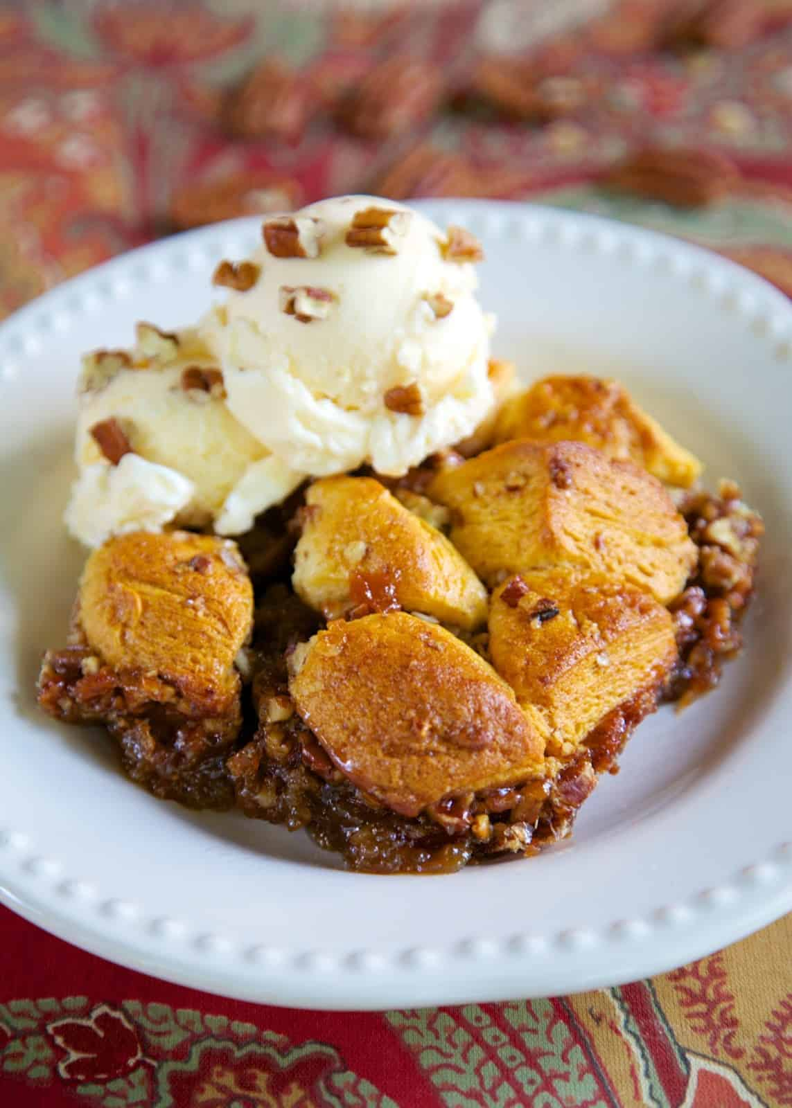 Pecan Pie Bubble Up - pecan pie filling tossed with biscuits - crazy good!! Serve warm with vanilla ice cream! Everyone LOVES this easy dessert recipe. Always the first thing to go!