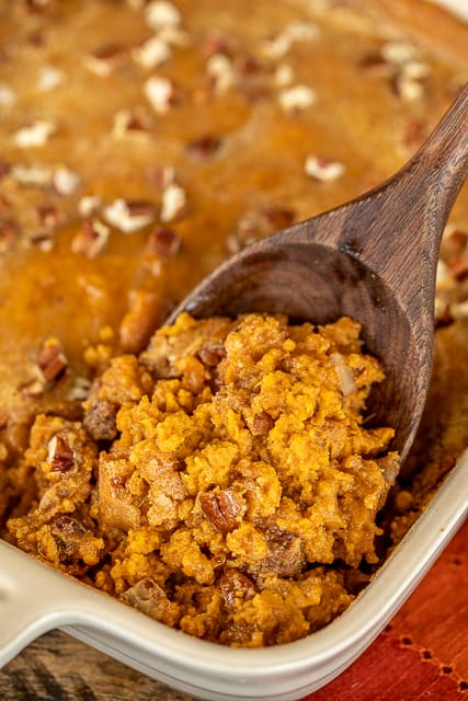 Praline Sweet Potato Casserole - our new favorite sweet potato casserole!! Mashed sweet potatoes topped with a crunchy praline topping - so much better than our usual marshmallow topped casserole!!! Sweet potatoes, eggs, heavy cream, brown sugar, vanilla, pecans, pumpkin pie spice, butter, sweetened condensed milk. Can make a day in advance and refrigerate until ready to eat. Perfect for Thanksgiving and Christmas! #sidedish #thanksgiving #christmas #sweetpotatoes