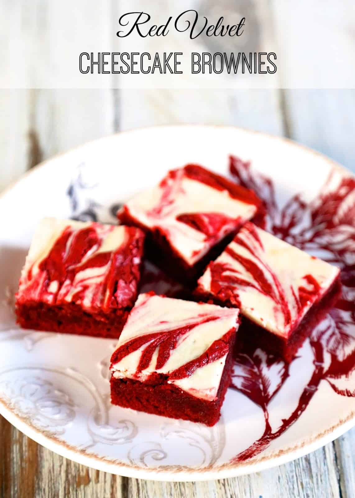 Red Velvet Cheesecake Brownies - homemade red velvet brownies with cheesecake swirled in the batter. All of my favorite desserts combined into one amazing recipe! These are SO good!!! Makes a great homemade gift. Perfect ending to you holiday meal. We love this red velvet brownie recipe!
