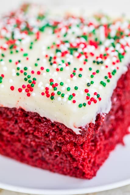 Red Velvet Poke Cake - red velvet cake soaked in sweetened condensed milk and chocolate and topped with a quick homemade cream cheese frosting. SO good! Great for potlucks and the holidays. #redvelvetcake #dessert #cakerecipe #christmas #valentinesday