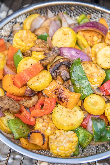 Roasted Garlic Grilled Vegetables - great as a side dish or tossed in pasta. Such an EASY side dish!! Bell peppers, onion, mushrooms, corn and squash tossed in olive oil, brown sugar, paprika, chili powder, salt, pepper and garlic. Ready to eat in about 15 minutes! #grilling #vegetables #sidedish #easysidedish #healthysidedish #lowcarb